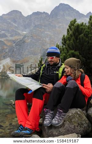 Trekkers - family adventure on mountain trek - stock photo
