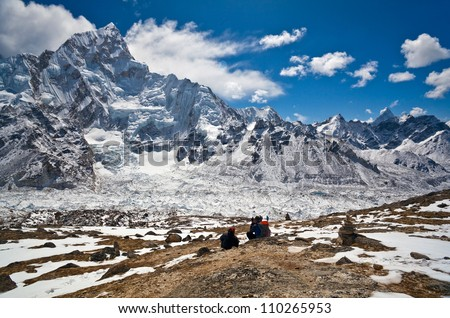Trekkers going to see Mt. Everest up close attempt to climb to the top of Kala Patthar in Sagarmatha National park, Nepal - stock photo