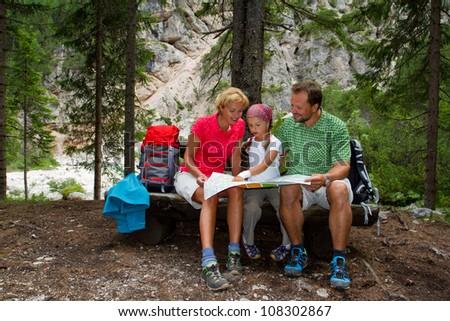 Trekking - Family planning mountain trek - stock photo