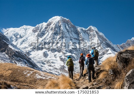 Trekking in Annapurna region, with Annapurna South in background, Nepal  - stock photo