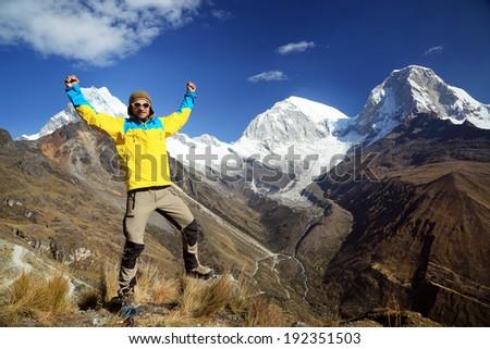 Trekking in Cordiliera Blanca - Huascaran Norte (6655m) and Huascaran Sur (6768 m) peaks in Cordileira Blanca, Peru, South America - stock photo