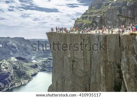 Trekking in Norwegian fjords - view of Preikestolen (aka Pulpet Rock) from the trail side (Lysefjord) - stock photo