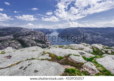 Trekking in Norwegian fjords - view over Lysefjord from a cliff - stock photo
