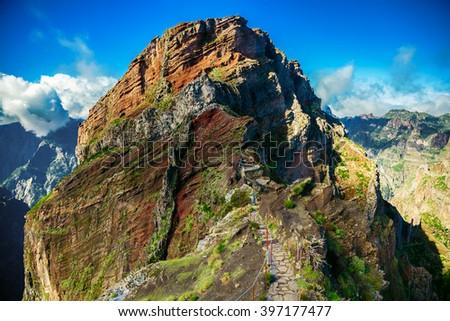 trekking path leading to the big cliff at the Pico do Arieiro surrounding areas, Madeira, Portugal - stock photo