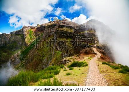 trekking path leading to the third highest peak of Madeira - Pico do Arieiro - stock photo