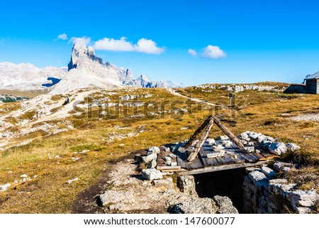 Trenches at Monte Piana, Dolomites; Tre Cime peak in background - stock photo