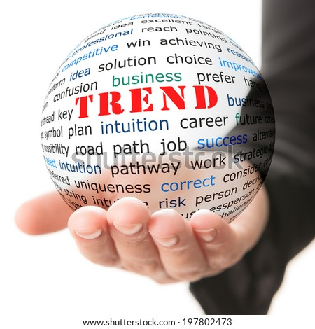 Trend concept. Hand take transparet ball with red inscription trend - stock photo