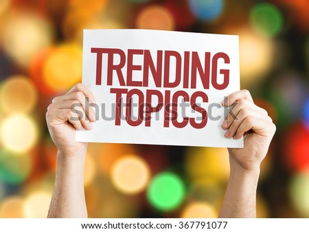 Trending Topics placard with bokeh background - stock photo