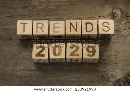 Trends for 2029 text on a wooden background - stock photo