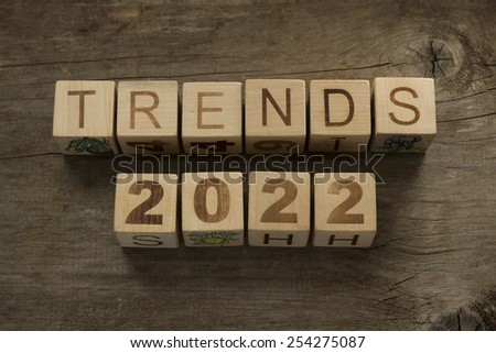 Trends for 2022 text on a wooden background - stock photo