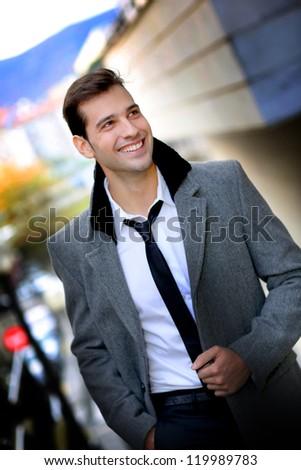 Trendy active man walking in town - stock photo