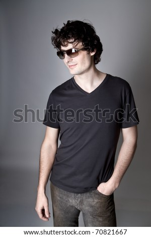 Trendy european man with sunglasses. He is now a professional model. - stock photo