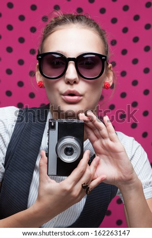 trendy girl posing during a taking selfie. Duckface - stock photo