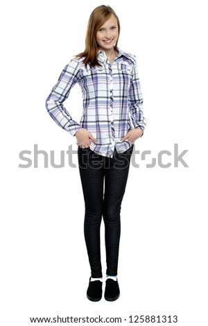 Trendy girl with long hair posing smartly. Full length shot against white background. - stock photo
