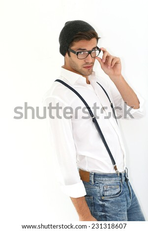 Trendy guy with suspenders and eyeglasses, isolated - stock photo