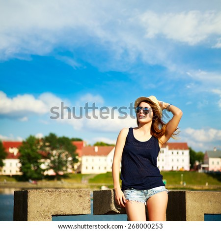 Trendy Hipster Girl Relaxing in the City. Modern Youth Lifestyle Concept. Copy Space. - stock photo