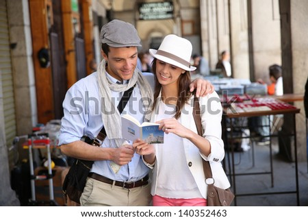 Trendy in love couple visiting Madrid - stock photo