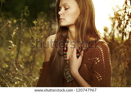 trendy look of a beautiful, mysterious girl in forest, mother preroda, fashion spring autumn - stock photo