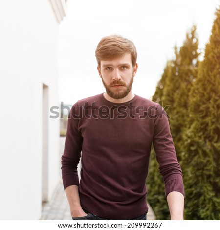 Trendy man with a beard on a sunny day - stock photo