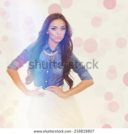 Trendy pretty woman in summer outfit. Gorgeous brunette girl in denim shirt and white skirt laughing and posing. Retouched, square format, matte instagram filter look, pink bokeh effect.  - stock photo