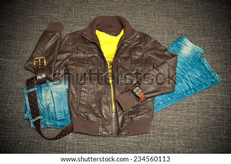 Trendy set for youth. leather jacket, jeans with a belt, shirt, watches - stock photo