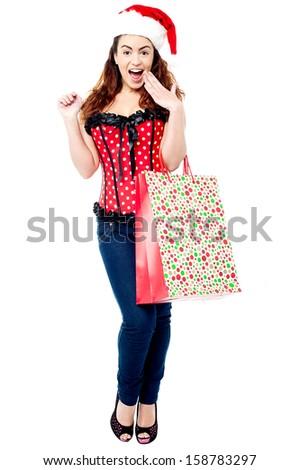 Trendy shocked woman carrying polka bag - stock photo