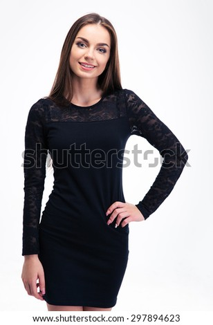Trendy smiling woman posing isolated on a white background. Looking at camera - stock photo