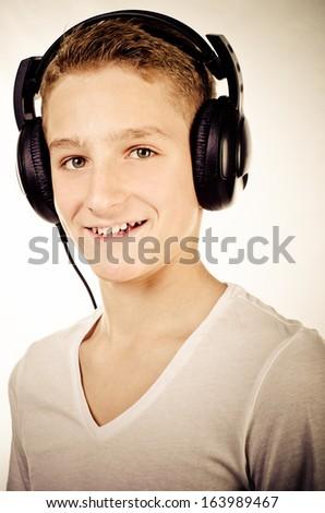 trendy teenage boy with headphones - stock photo