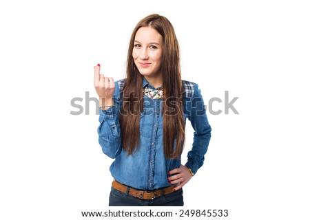 Trendy young woman doing the money gesture. Over white background - stock photo