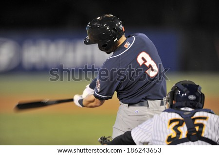 TRENTON, NJ - APRIL 4: New Hampshire Fisher Cats third baseman Ryan Schimpf (3) swings at a pitch during the Thunder home opener April 4, 2014 in Trenton, NJ.  - stock photo