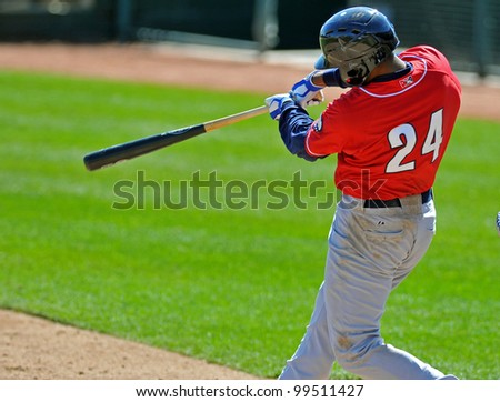 TRENTON, NJ - APRIL 7: New Hampshire third baseman Kevin Howard  swings at a pitch during the Eastern League game between Trenton and New Hampshire April 7, 2012 in Trenton, NJ. - stock photo