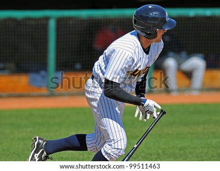 TRENTON, NJ - APRIL 7: Trenton shortstop Addison Maruszak runs for first base after making contact during the Eastern League game between Trenton and New Hampshire April 7, 2012 in Trenton, NJ. - stock photo