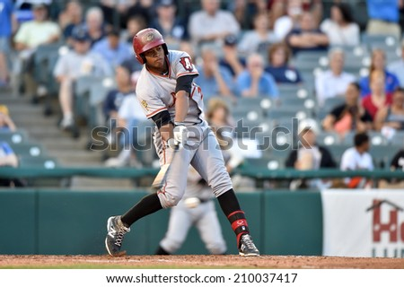 TRENTON, NJ - August 7: Altoona Curve right fielder Willy Garcia (24) bats during the Eastern League minor league baseball game played August 7, 2014 in Trenton, NJ.  - stock photo