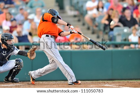 TRENTON, NJ - AUGUST 18:  Bowie Baysox player Buck Britton swings at a pitch during an Eastern League baseball game on August 18, 2012 in Trenton, NJ. - stock photo
