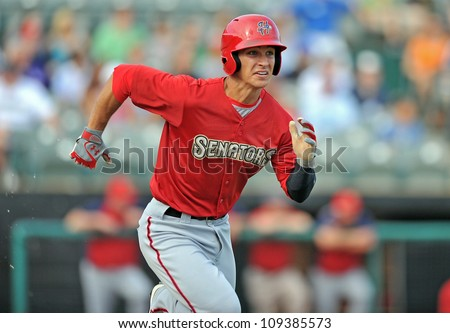 TRENTON, NJ - JULY 29: Harrisburg Senators batter Zach Walters runs to first base trying for a hit during an Eastern League baseball game July 29, 2012 in Trenton, NJ. - stock photo