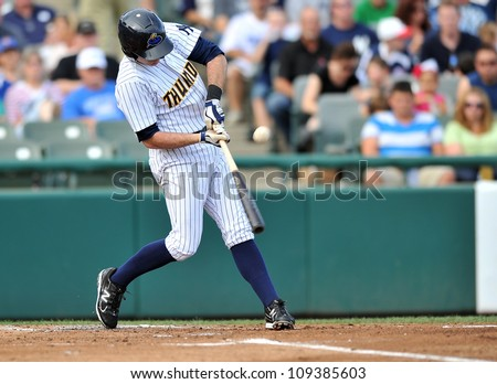 TRENTON, NJ - JULY 29: Trenton Thunder batter Addison Maruszak connects with a pitch during an Eastern League baseball game July 29, 2012 in Trenton, NJ. - stock photo