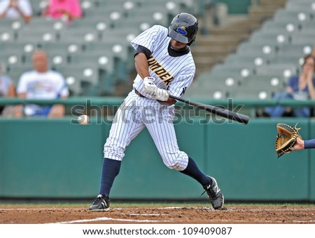 TRENTON, NJ - JULY 28: Trenton Thunder batter Zolio Almonte swings at a pitch during an Eastern League baseball game July 28, 2012 in Trenton, NJ. - stock photo