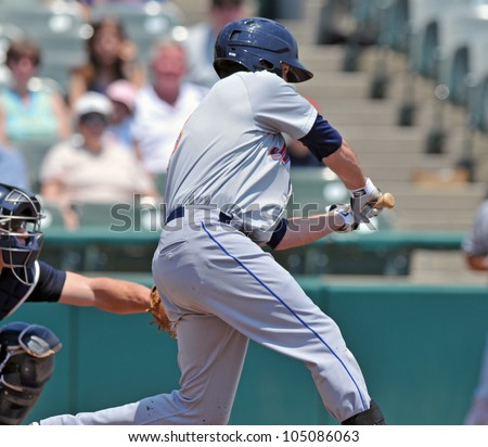 TRENTON, NJ - JUNE 10: Binghamton Mets batter Reese Havens swings and misses at a pitch during the Eastern League baseball game June 10, 2012 in Trenton, NJ. - stock photo