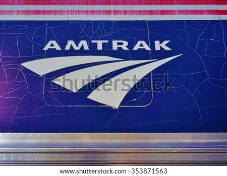TRENTON, NJ -12 JUNE 2015- Rusty and cracked paint Amtrak logo on the side of a Northeast Corridor train. - stock photo