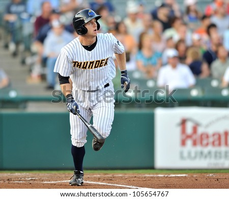 TRENTON, NJ - JUNE 19: Trenton Thunder batter David Adams watches a fly ball he hit as he runs to first during the Eastern League baseball game June 19, 2012 in Trenton, NJ. - stock photo