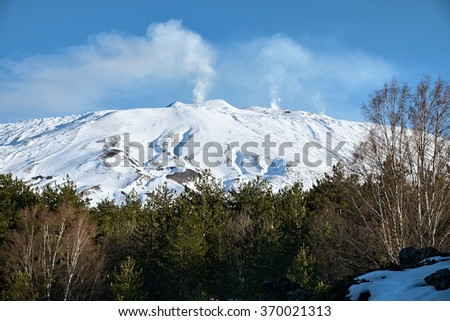 trhee plumes of smoke from central craters of Etna Volcano, Sicily  - stock photo