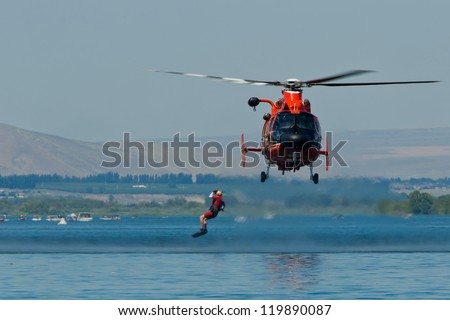 TRI-CITIES, WA - JULY 29: USCG Eurocopter HH-65C Dolphin Helicopter Rescue Demonstration Flight at the Lamb Weston Columbia Cup July 29, 2012 on the Columbia River in Tri-Cities, WA. - stock photo