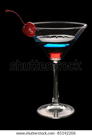 Tri-color cocktail martini with a cherry on a black background - stock photo