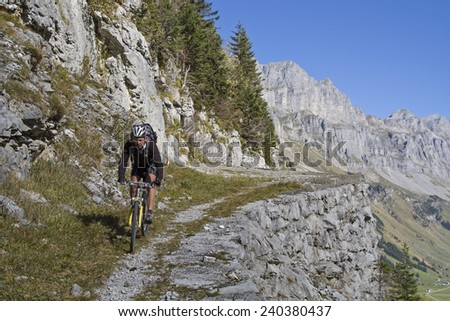 Trial mountain bike trip from Klausen Pass to Glarus - stock photo