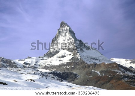 triangular shaped Matterhorn mountain in the Pennine Alps on the border between Switzerland and Italy - stock photo