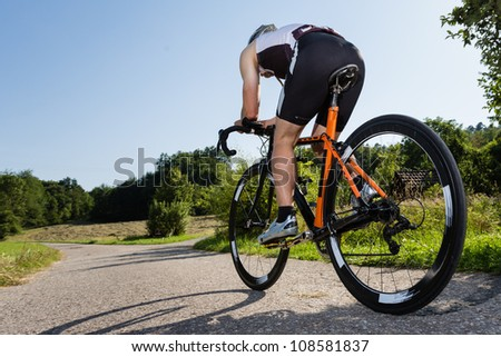 triathlete on a bicycle in time trial - stock photo