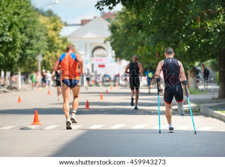 Triathlon Cup of Ukraine and Cup of Bila Tserkva. July 24, 2016 in Bila Tserkva, Ukraine. Running man on crutches - stock photo