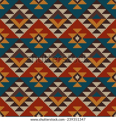 Tribal Aztec Pattern on the wool knitted texture. Seamless Background - stock photo