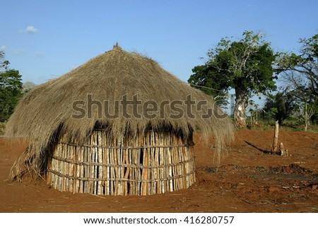tribal hut in a village in Mozambique - stock photo