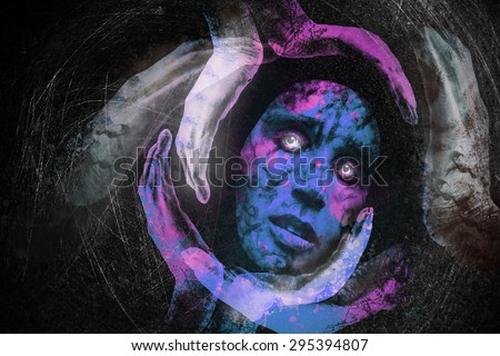 Tribal mask of a woman with sad eyes, glance, surrounded with gloving hands holding her on a black background .The image is about meditation, loneliness in the universe in search of spirituality - stock photo